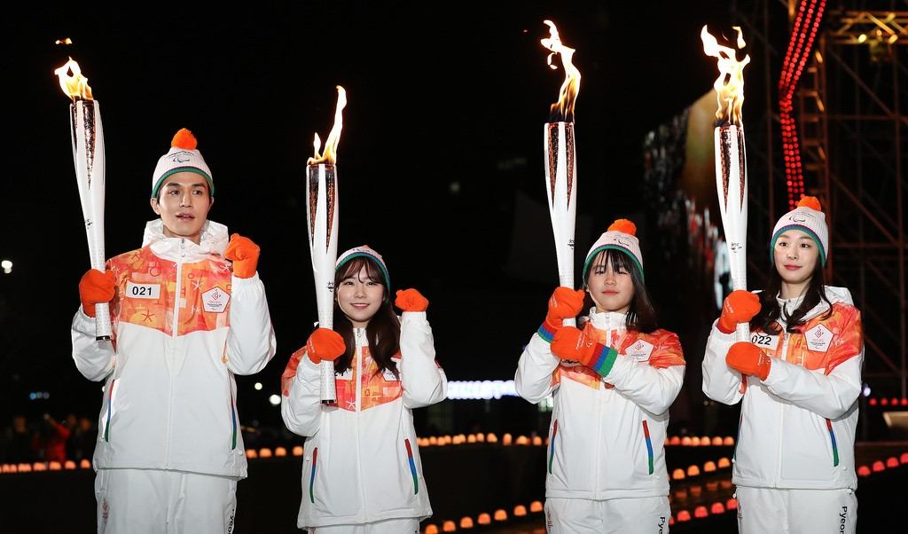 South Korean torchbearers reigniting the flame for the 2018 PyeongChang Winter Paralympic Games.