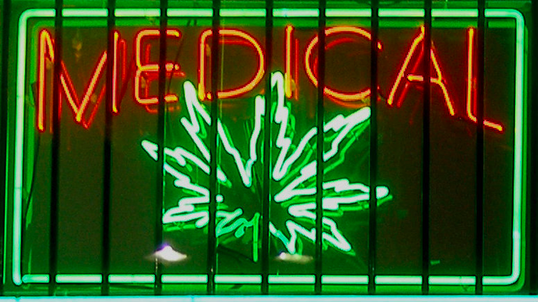 A sign in the storefront of an illegal medical marijuana clinic.