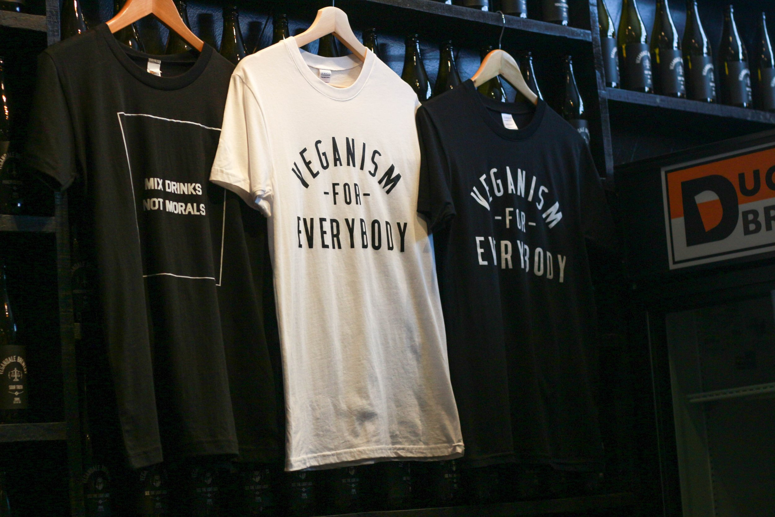 The Vegandale collective proudly displays their slogan on branded merchandise at the front counter of Vegandale Brewery on Queen Street West. (The Unaffiliated Press/Kayla Zhu)