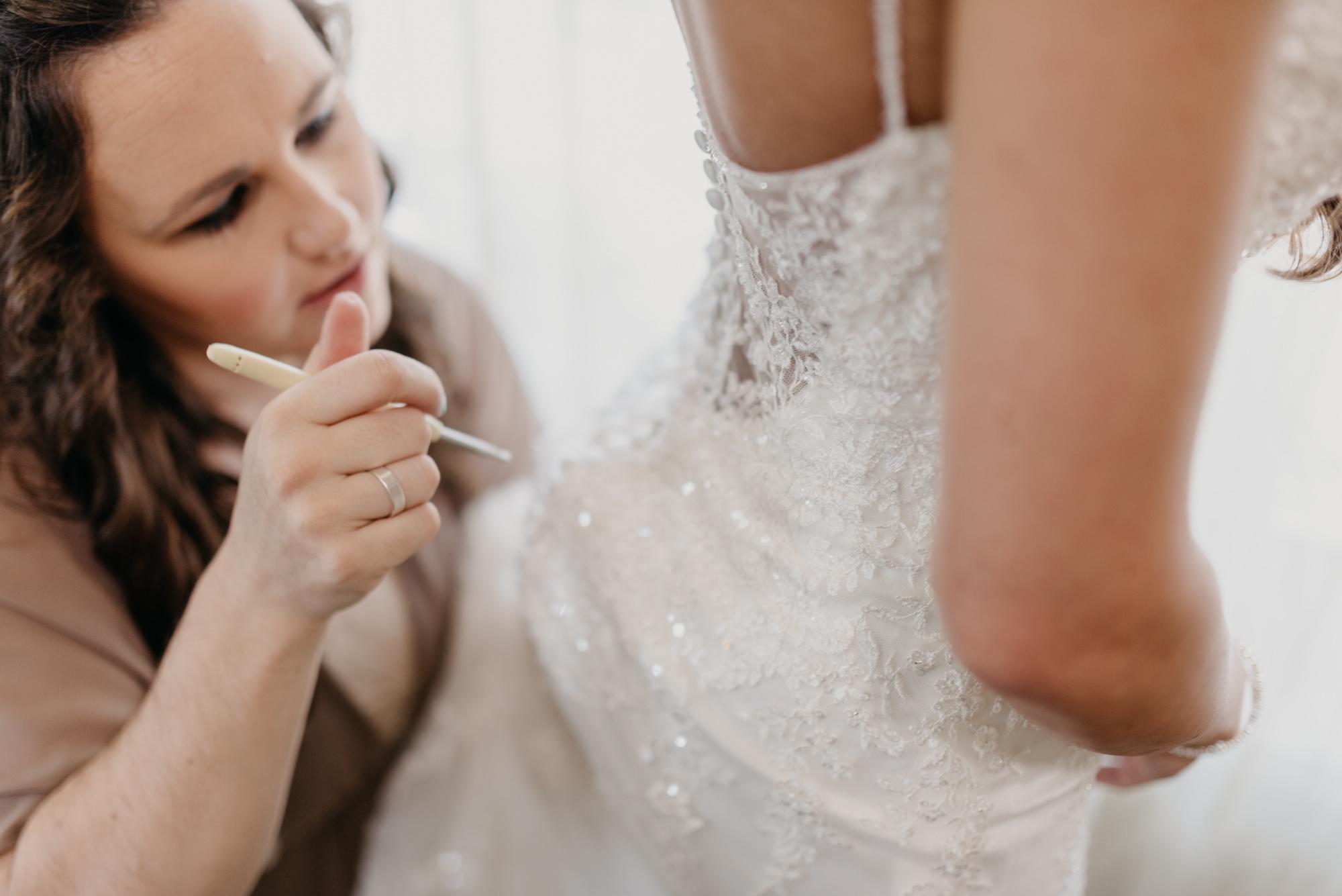 22-Getting-Ready-barn-kestrel-wedding-photos-grey-suit.jpg
