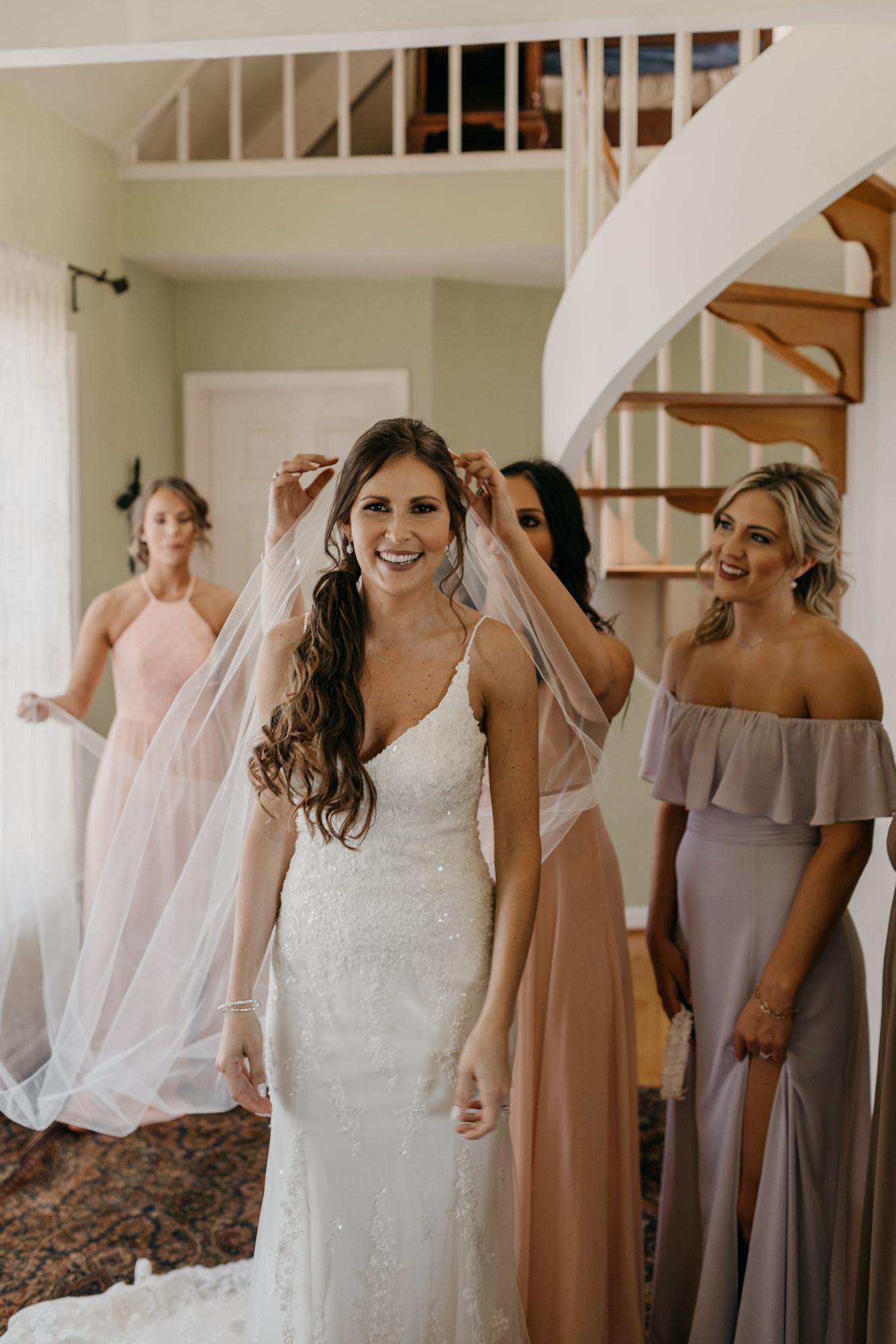 28-Getting-Ready-barn-kestrel-wedding-photos-grey-suit.jpg