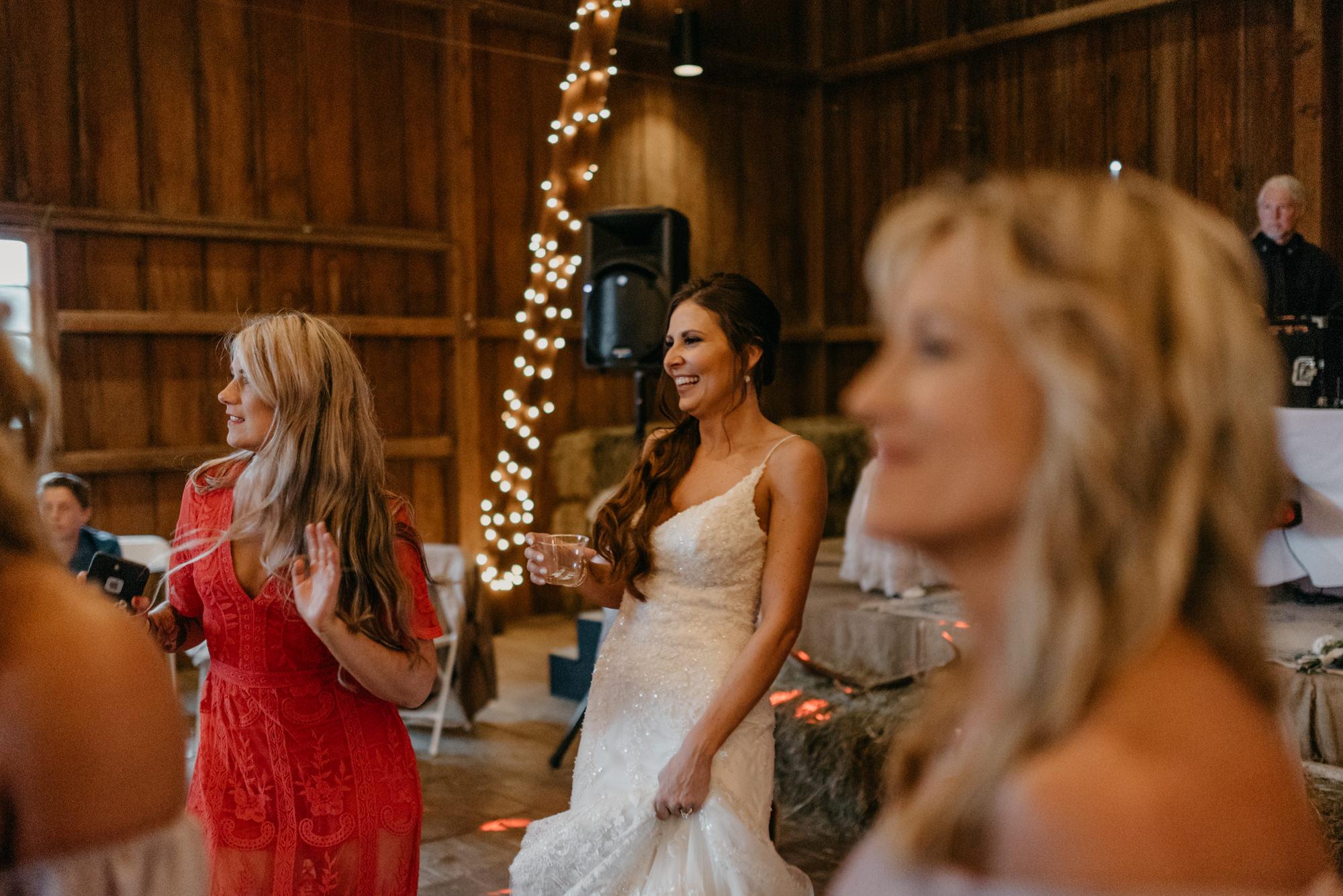 199-portland-northwest-wedding-bubble-exit-barn-string-lights.jpg