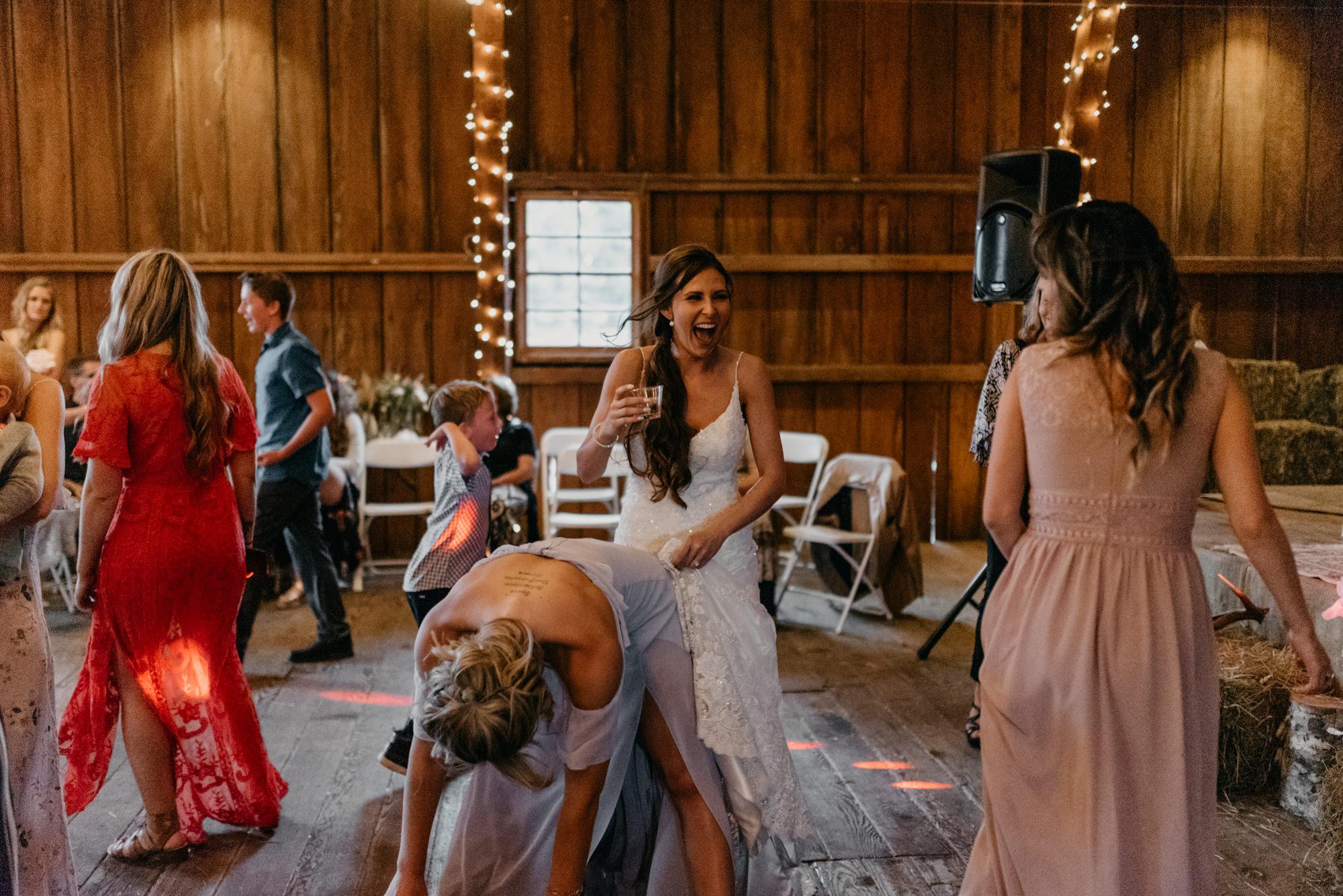 202-portland-northwest-wedding-bubble-exit-barn-string-lights.jpg
