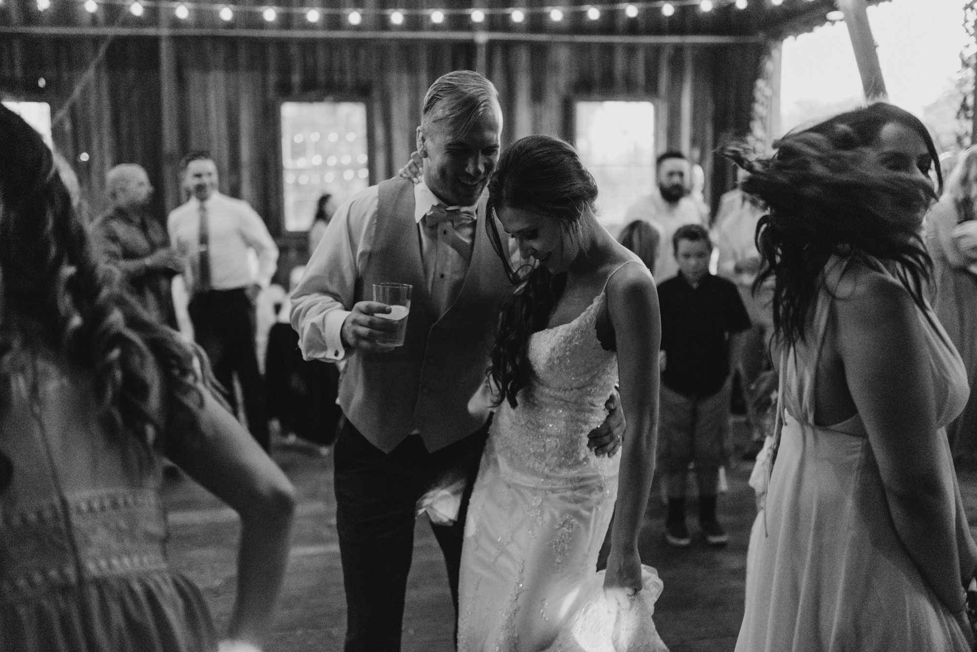 208-portland-northwest-wedding-bubble-exit-barn-string-lights.jpg