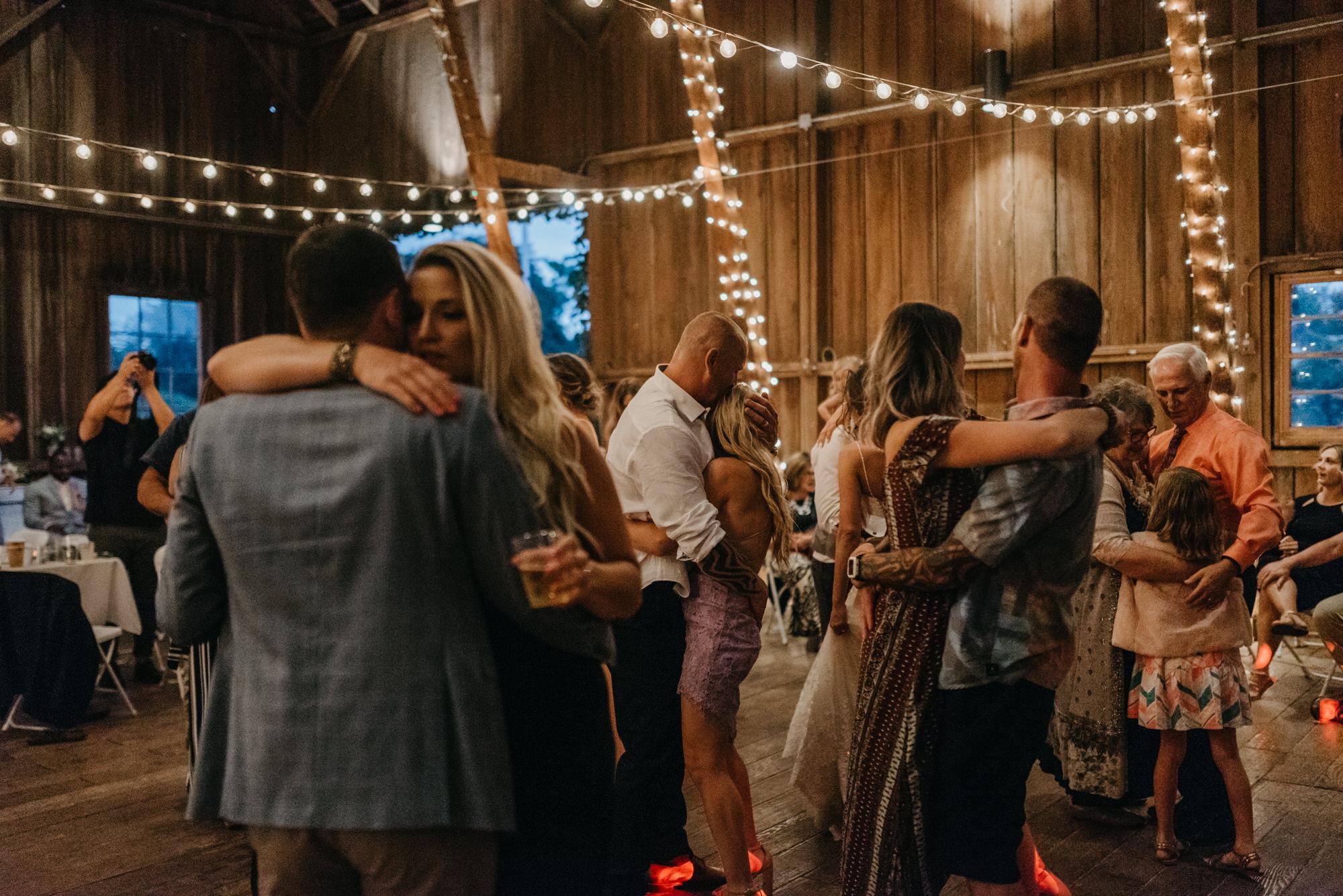 215-portland-northwest-wedding-bubble-exit-barn-string-lights.jpg