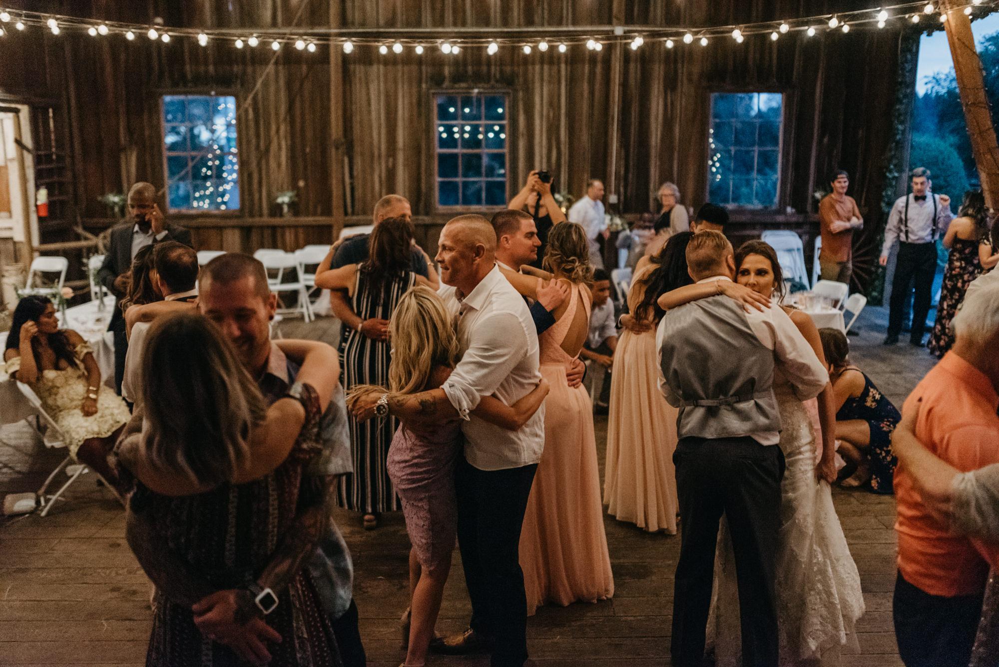 216-portland-northwest-wedding-bubble-exit-barn-string-lights.jpg