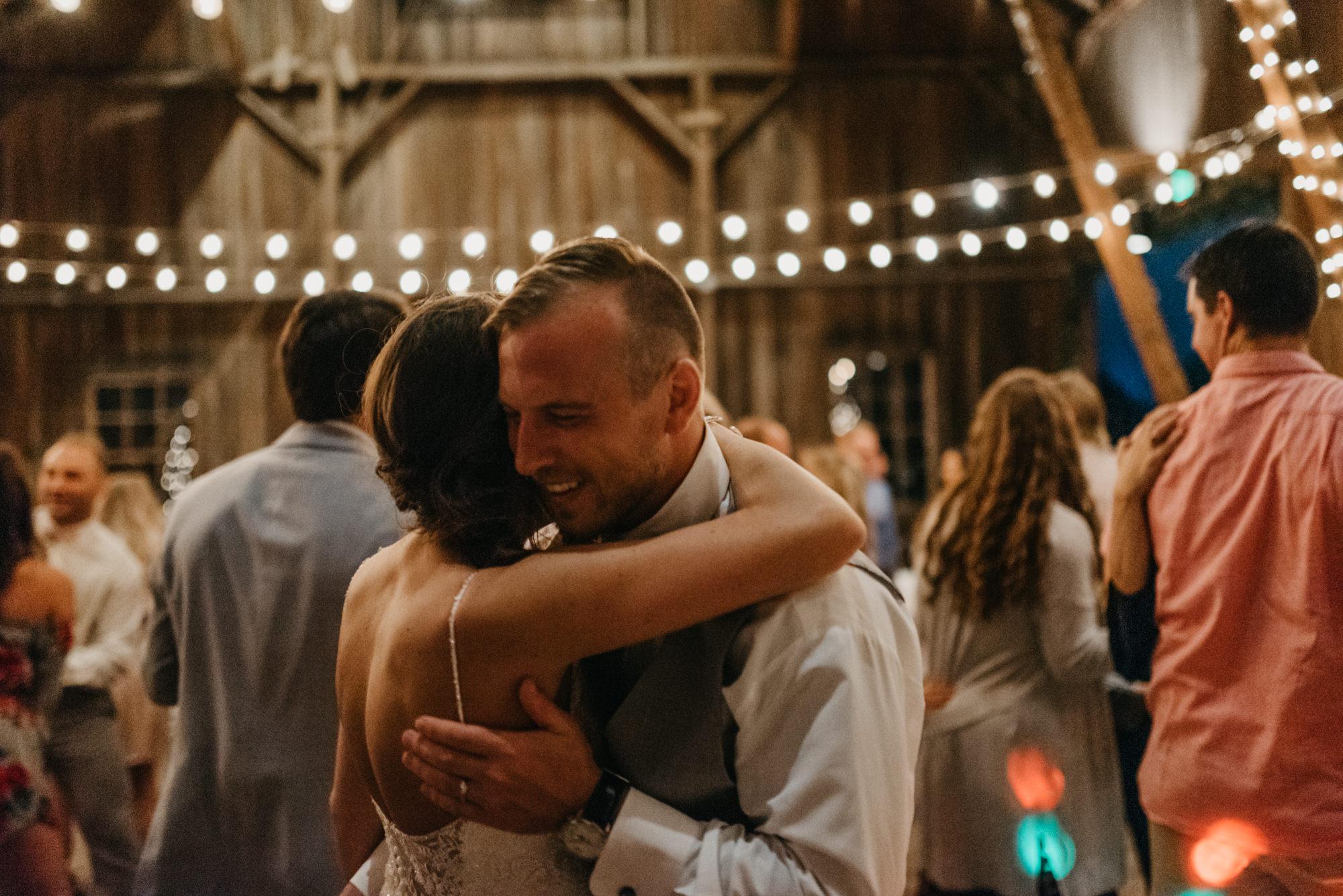 219-portland-northwest-wedding-bubble-exit-barn-string-lights.jpg