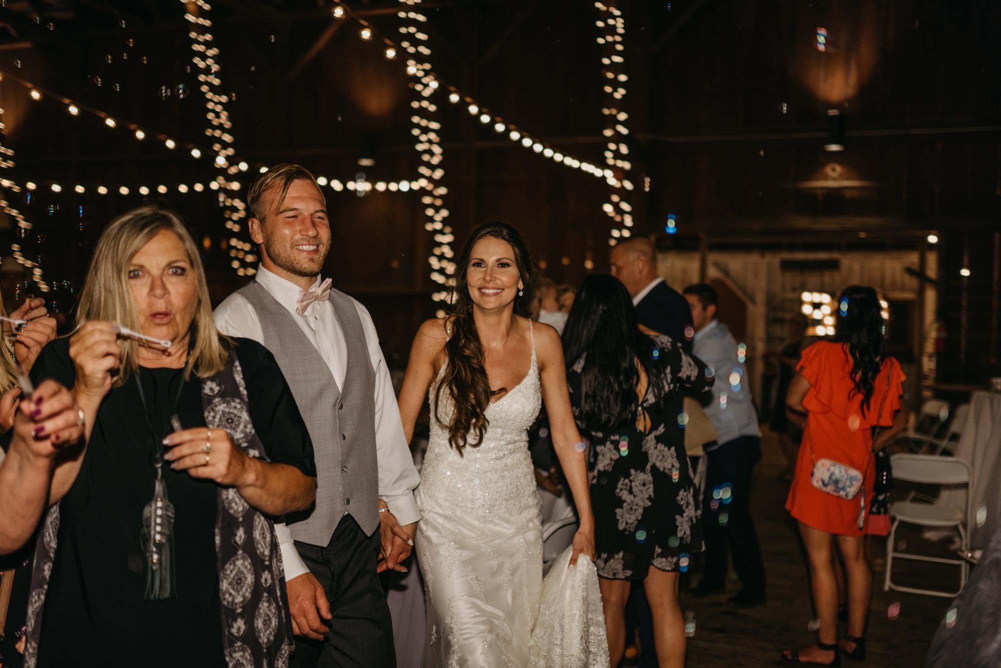 221-portland-northwest-wedding-bubble-exit-barn-string-lights.jpg