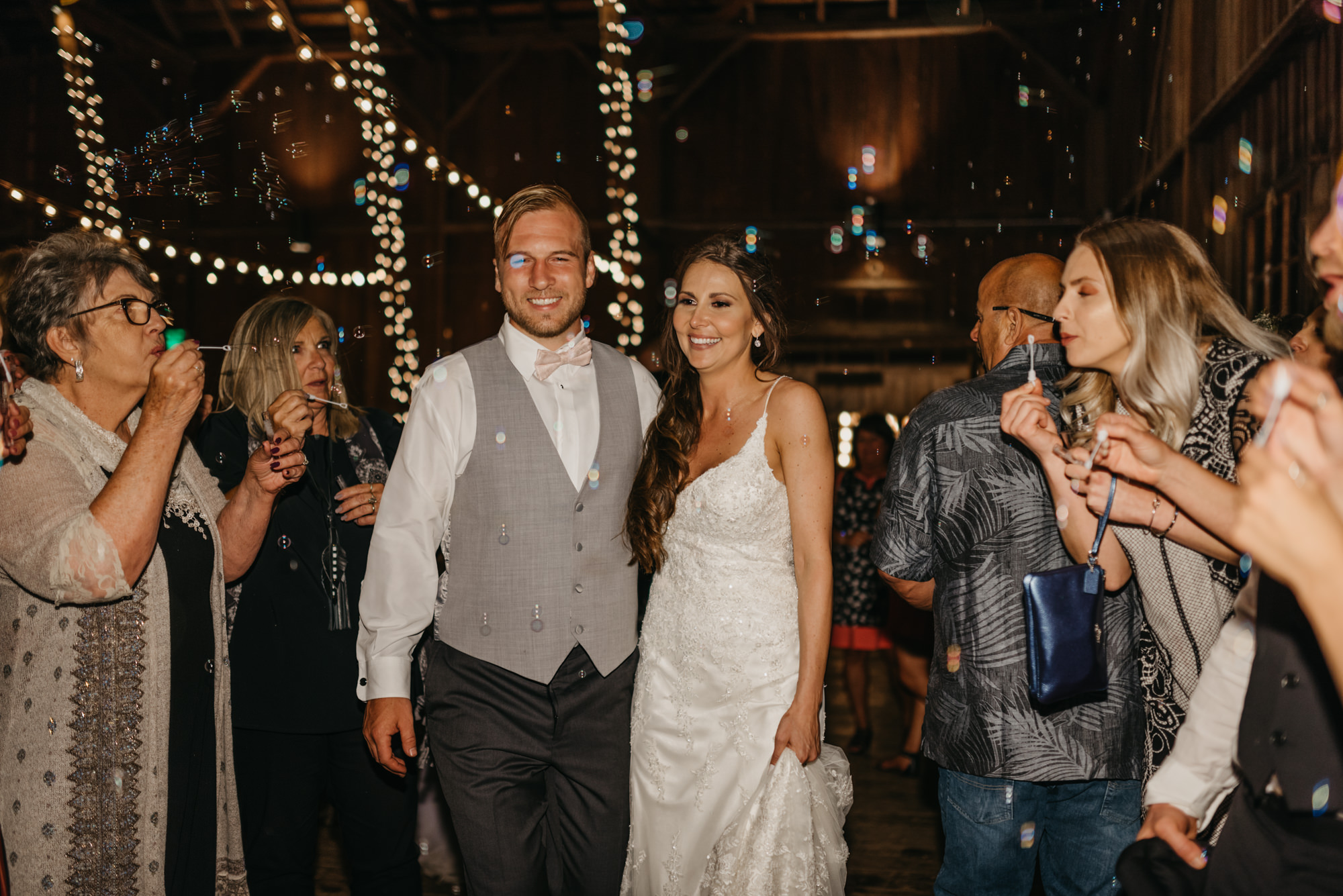 223-portland-northwest-wedding-bubble-exit-barn-string-lights.jpg