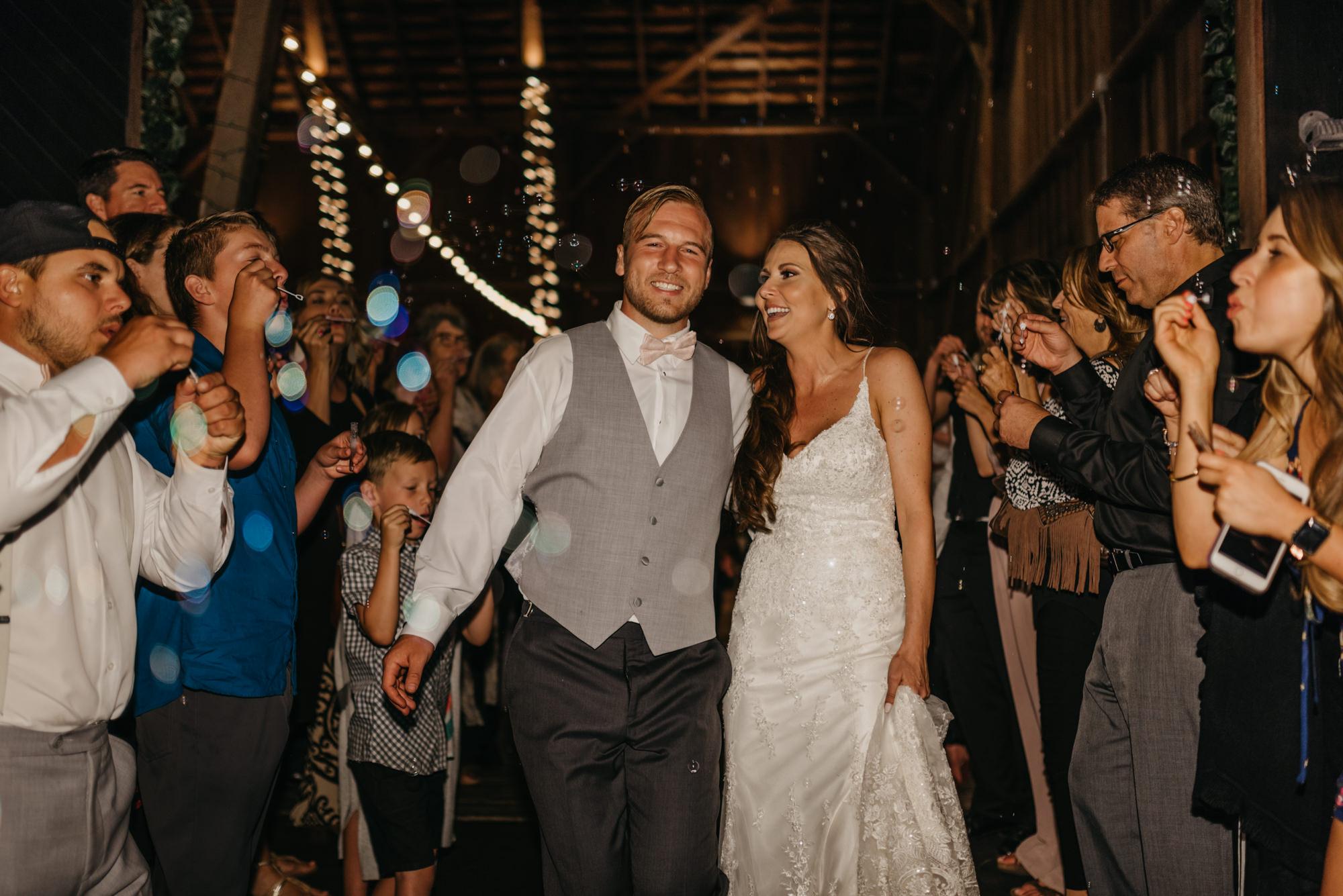 224-portland-northwest-wedding-bubble-exit-barn-string-lights.jpg