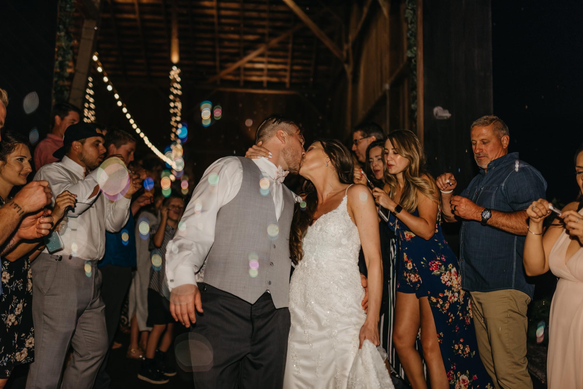 226-portland-northwest-wedding-bubble-exit-barn-string-lights.jpg