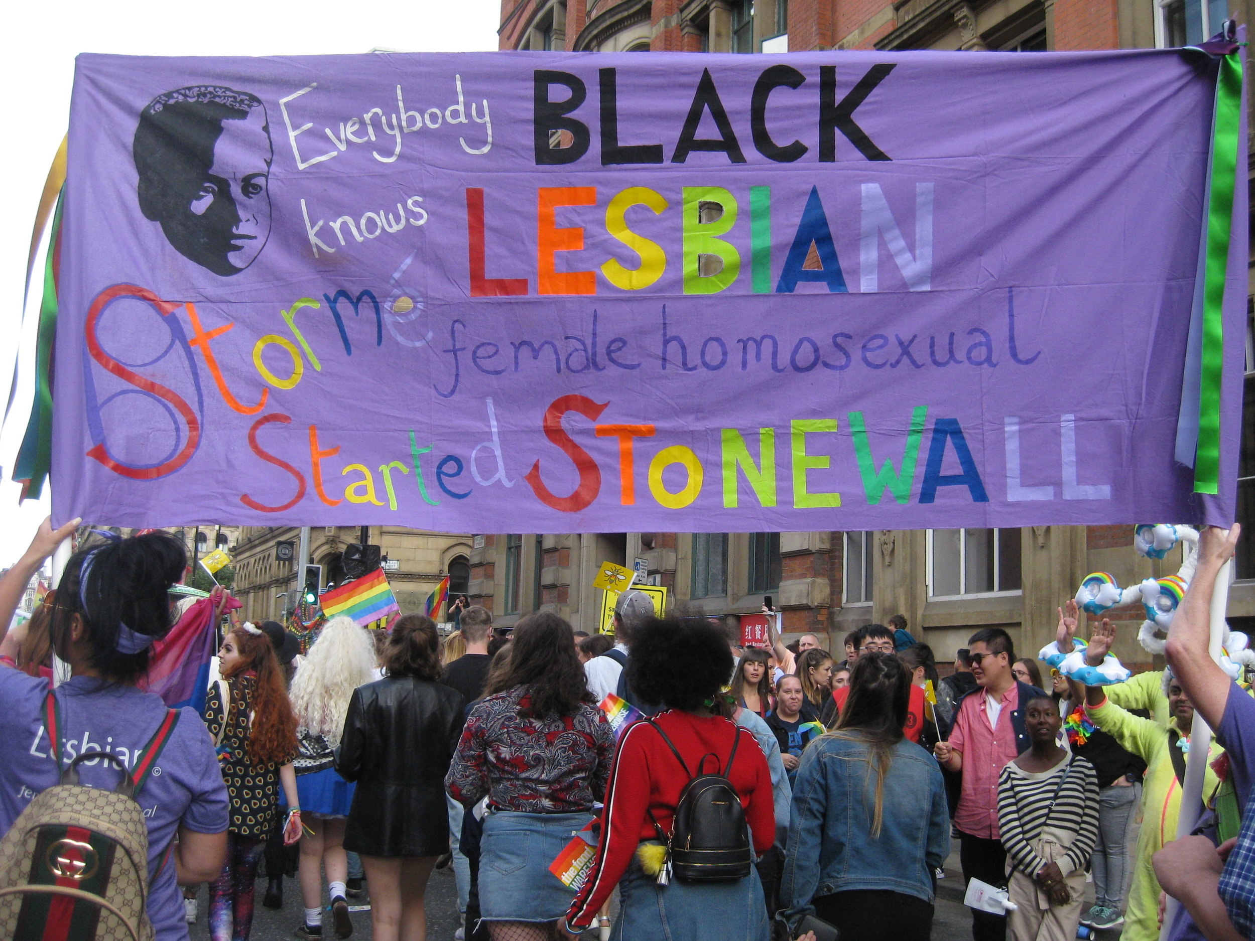 We marched in Manchester Pride parade 2018, carrying this stunning banner paying tribute to Stormé DeLaverie and representing  The Society for the Preservation of Accurate Pride Heritage.