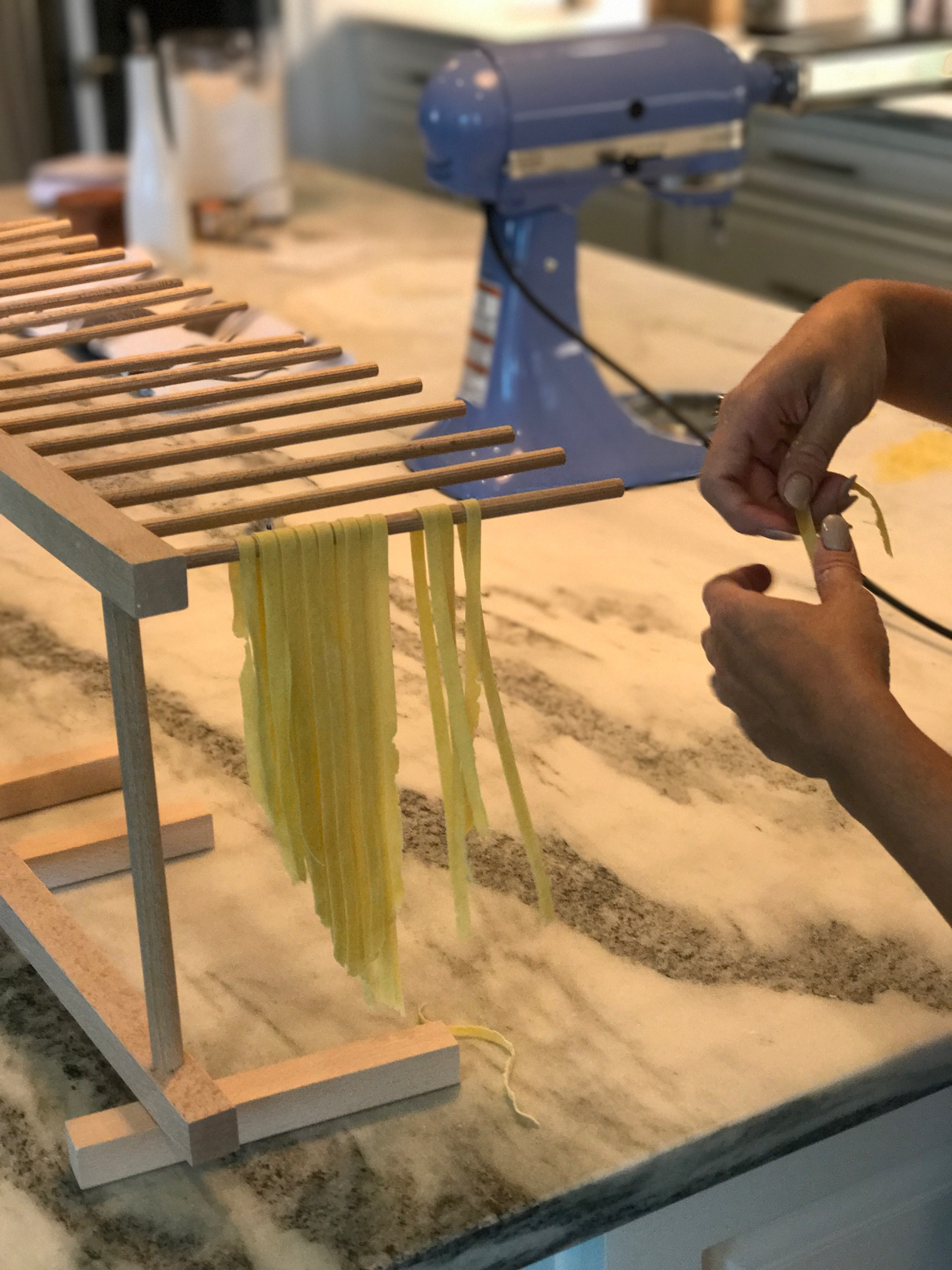 You can use wooden pasta racks or the backs of kitchen stools or chairs to hang your pasta.