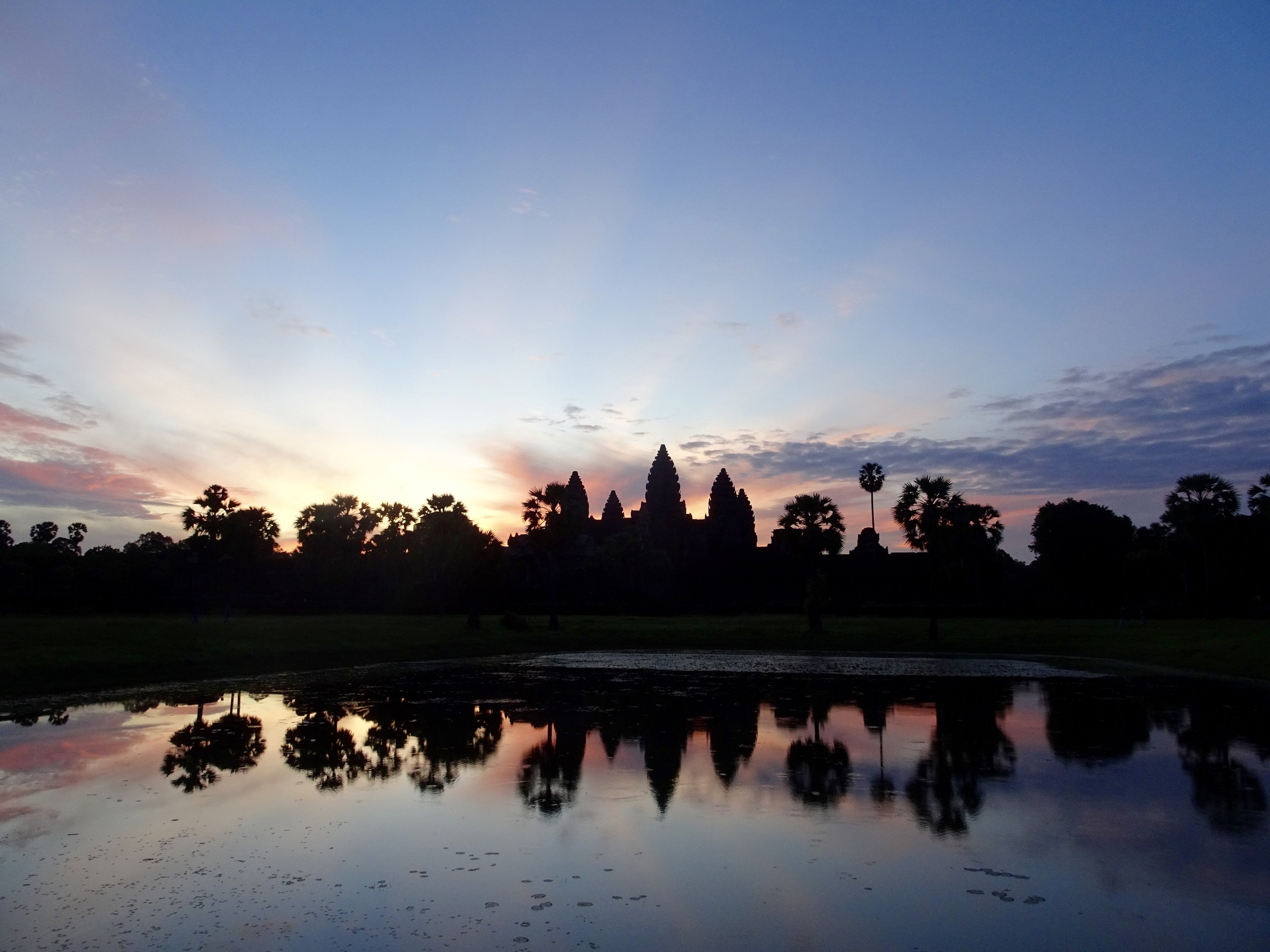 Angkor Wat, Cambodia - See the sun rise over Angkor Wat and cycle through rice patties in one of the world's most spectacular archeological sites.