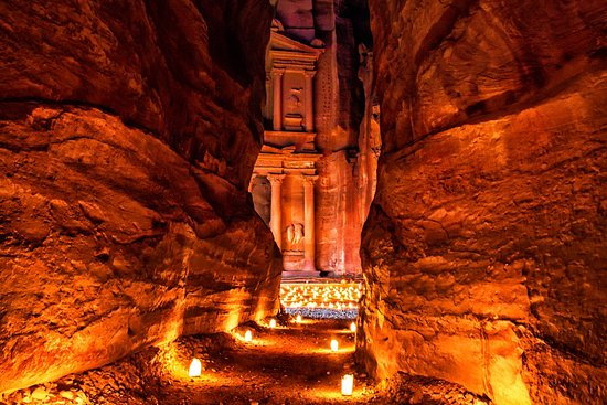 Petra, Jordan - Follow flickering luminarias to the ancient Treasury at Petra.