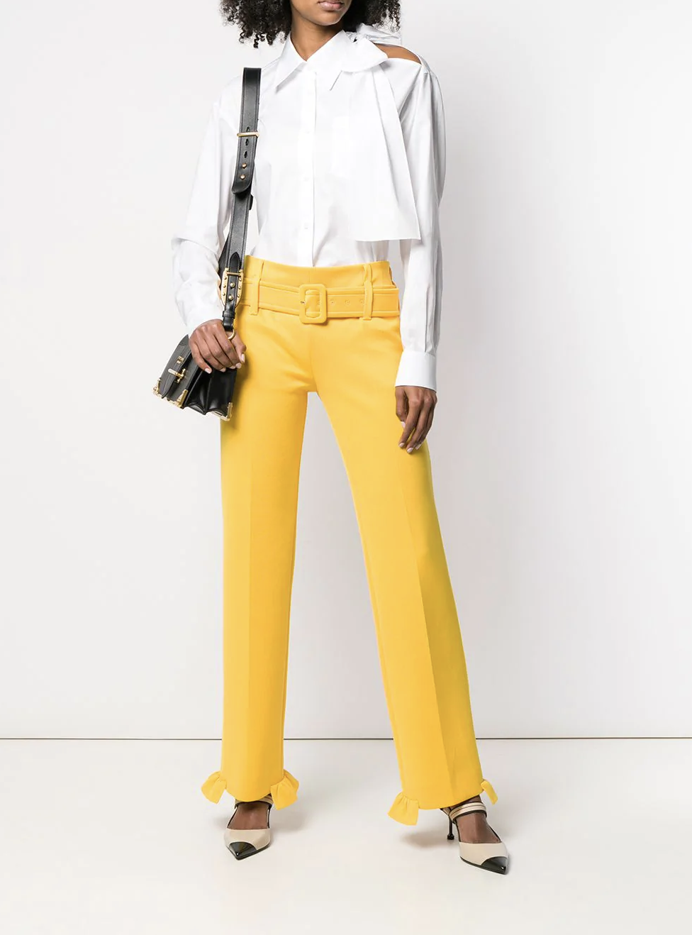 "Slim White Blouse - ""I have a lot of them—they are easy to wear and look great with a good pair of jeans regardless of where you are going or what you are doing."""