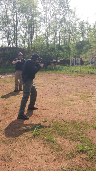 Mike demonstrates from the low ready to shooting position