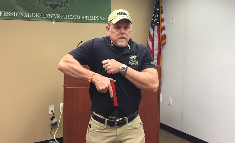 (Photo courtesy/Green Ops Training. NOTE: This photo depicts a training pistol device and is performed in a controlled environment. Always adhere to the Gun Safety Rules, and only aim a firearm at approved targets.)