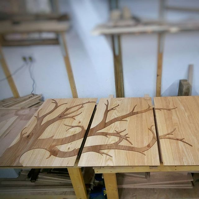 A wee sneak peek, a few photos of our current project. The tree design was first drawn, studied, re drawn, corrected, over and over untill satisfied. This was then delicately cut out from a thin panel of Scottish Elm. Lots of sanding and shaping before gluing to the main Ash panels. A vacuum bag was used to glue in position, meaning that every branch and small tip had even pressure to create the best bond. We used a @roarockituk vacuum bag which we cannot recommend enough! Fantastic piece of kit. No need for an expensive vacuum pump. Thanks guys!  #elm #scottish #bespoke #design #unique #tree #handmade #ash #panels #furniture #original #custom #highwoodfurniture #branches #beautiful #special #customfurniture #bespokefurniture #uniquedesign #uniquewoodwork #wood