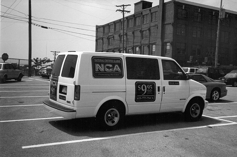 White NCA Alarms work van with brand name and monitoring price on the side - NCA Alarms Nashville TN