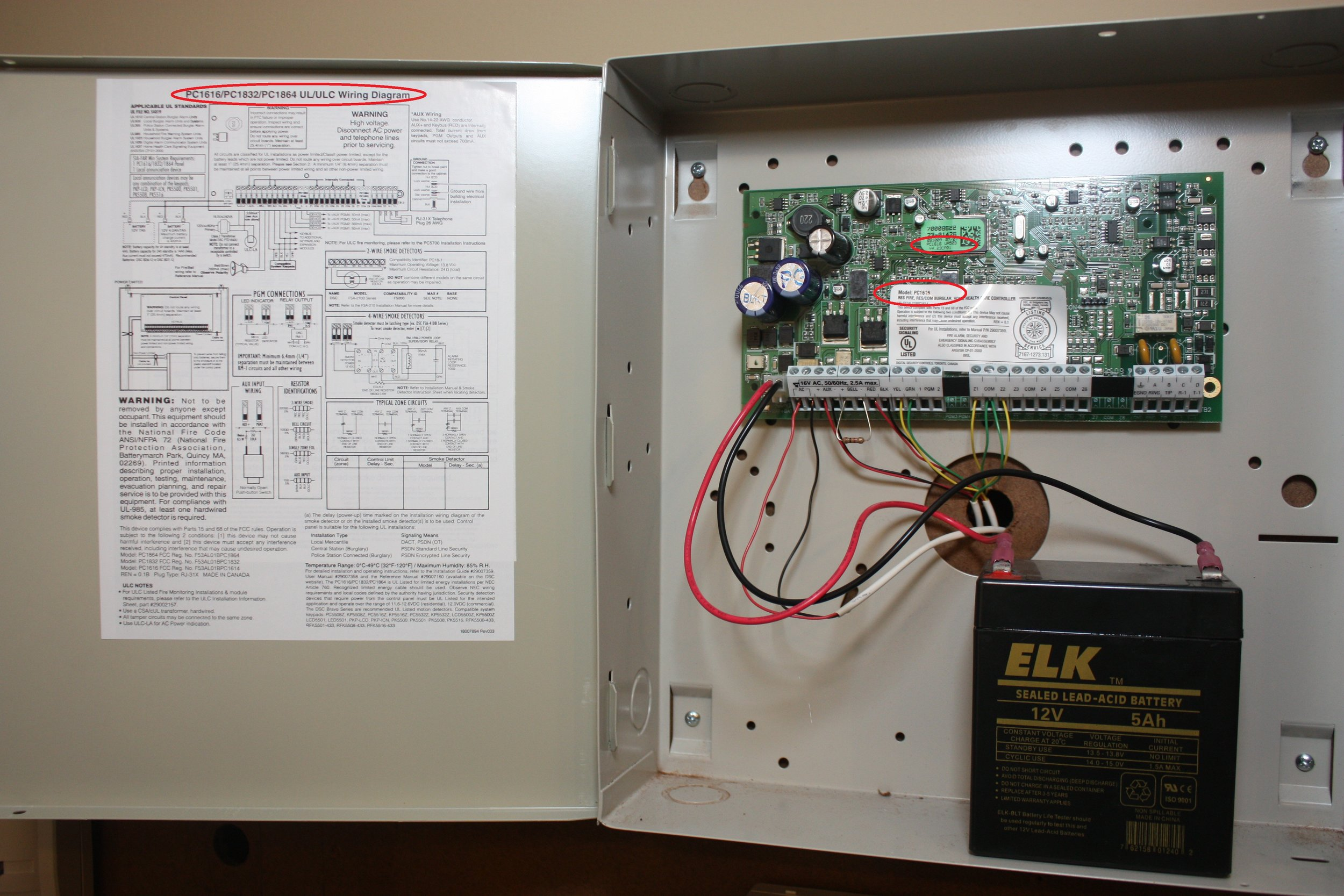 Inside the 5508 DSC LED alarm control box showing the schematic and circuit board - NCA Alarms Nashville TN