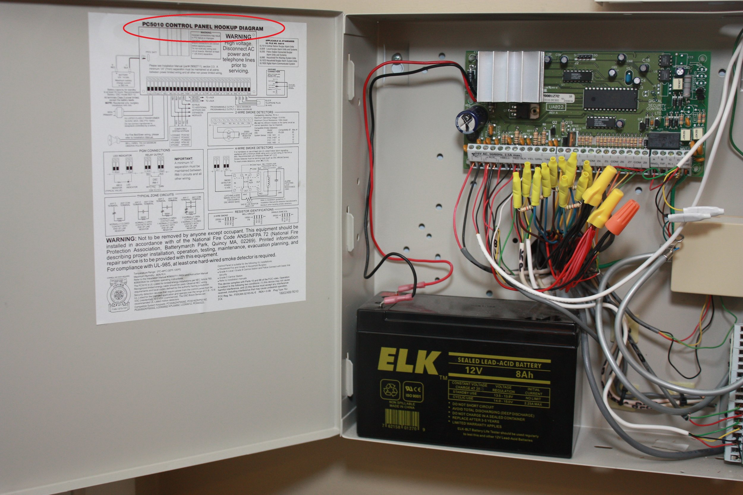 Inside the 5501 DSC Power Series Fixed English alarm control box showing the schematic and circuit board - NCA Alarms Nashville TN