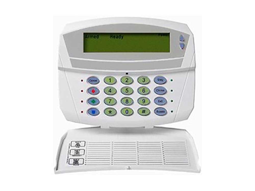 Keypad for the Caddx NX 1192e Custom Alpha alarm system with the protection cover open - NCA Alarms Nashville TN