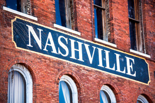 """Picture of a painted brick wall that says """"Nashville"""""""