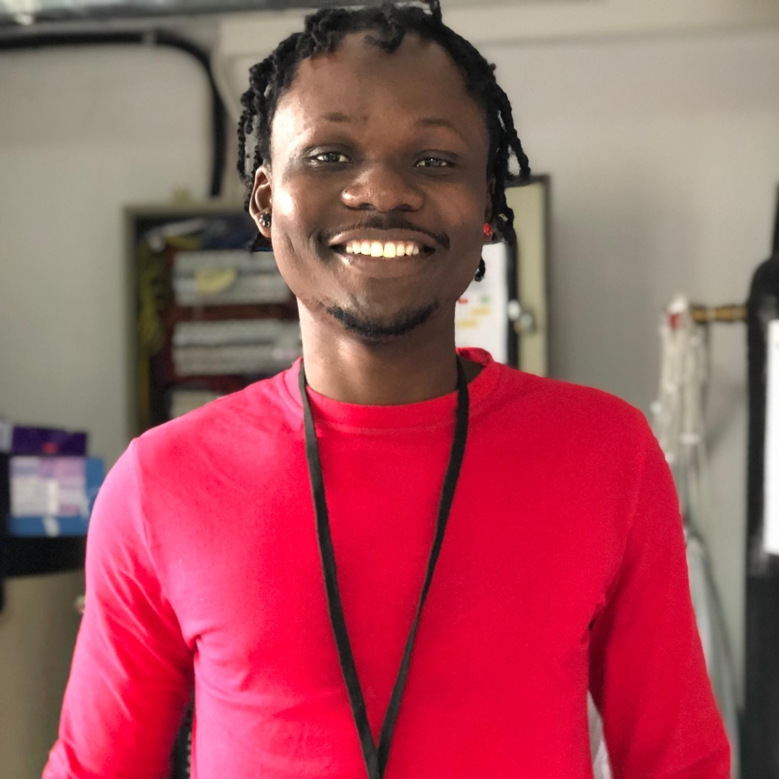 """Yussif, 25 - Ghana   """"I love Alpha because the people are nice and it's a nice place to spend time. I get time to forget about the reason why I fled.""""  Yussif loves constantly learning and politics."""