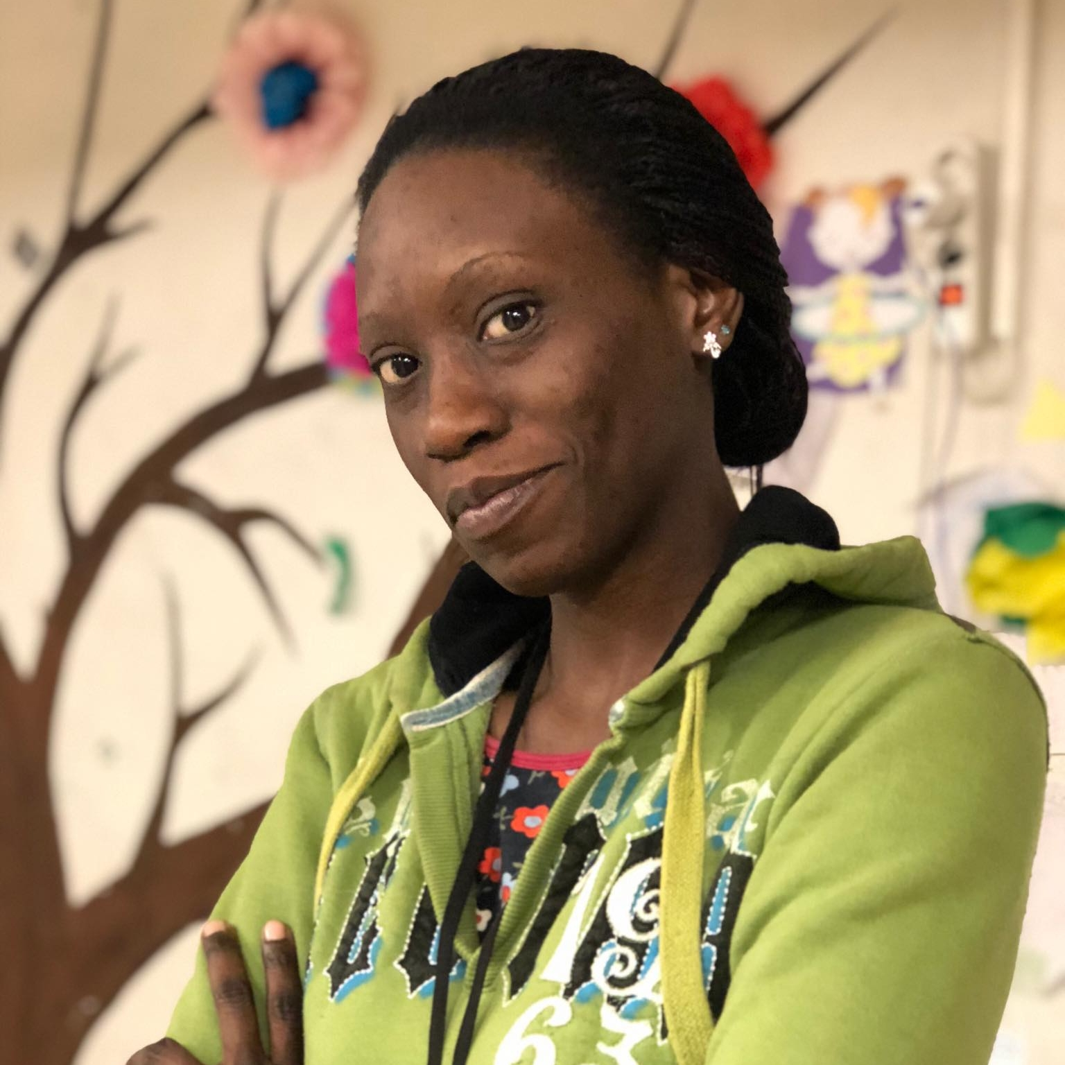 """Nelly, 30 - Uganda   """"As a teacher, I'm obliged to pass on knowledge wherever I am. Because despite my current condition, I have the urge to share whatever little I have."""""""