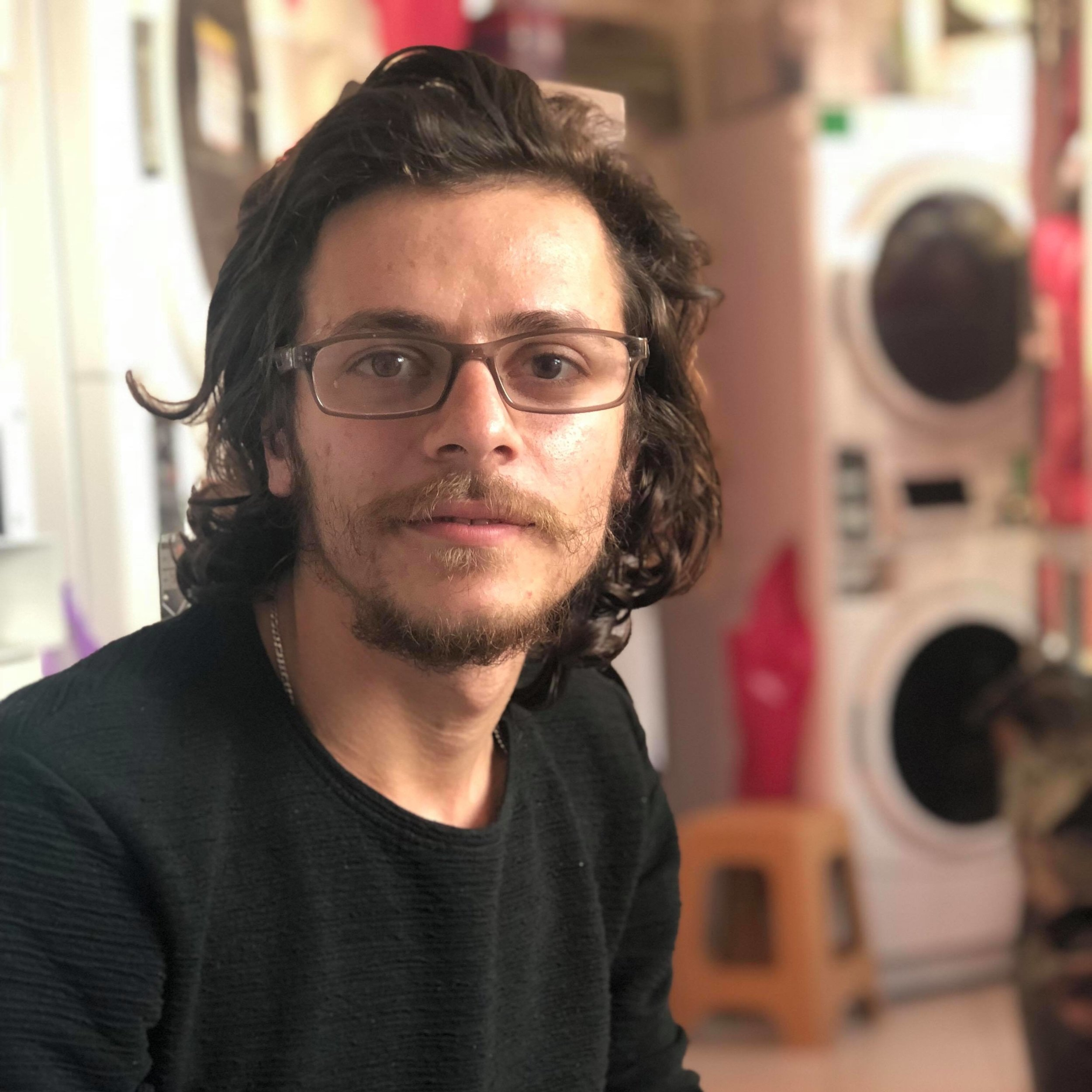 "Mohammed K, 24 - Syria      ""I like to help. Laundry is my favourite thing to do because it's quiet and I think it's very important for the people up in the camp."""