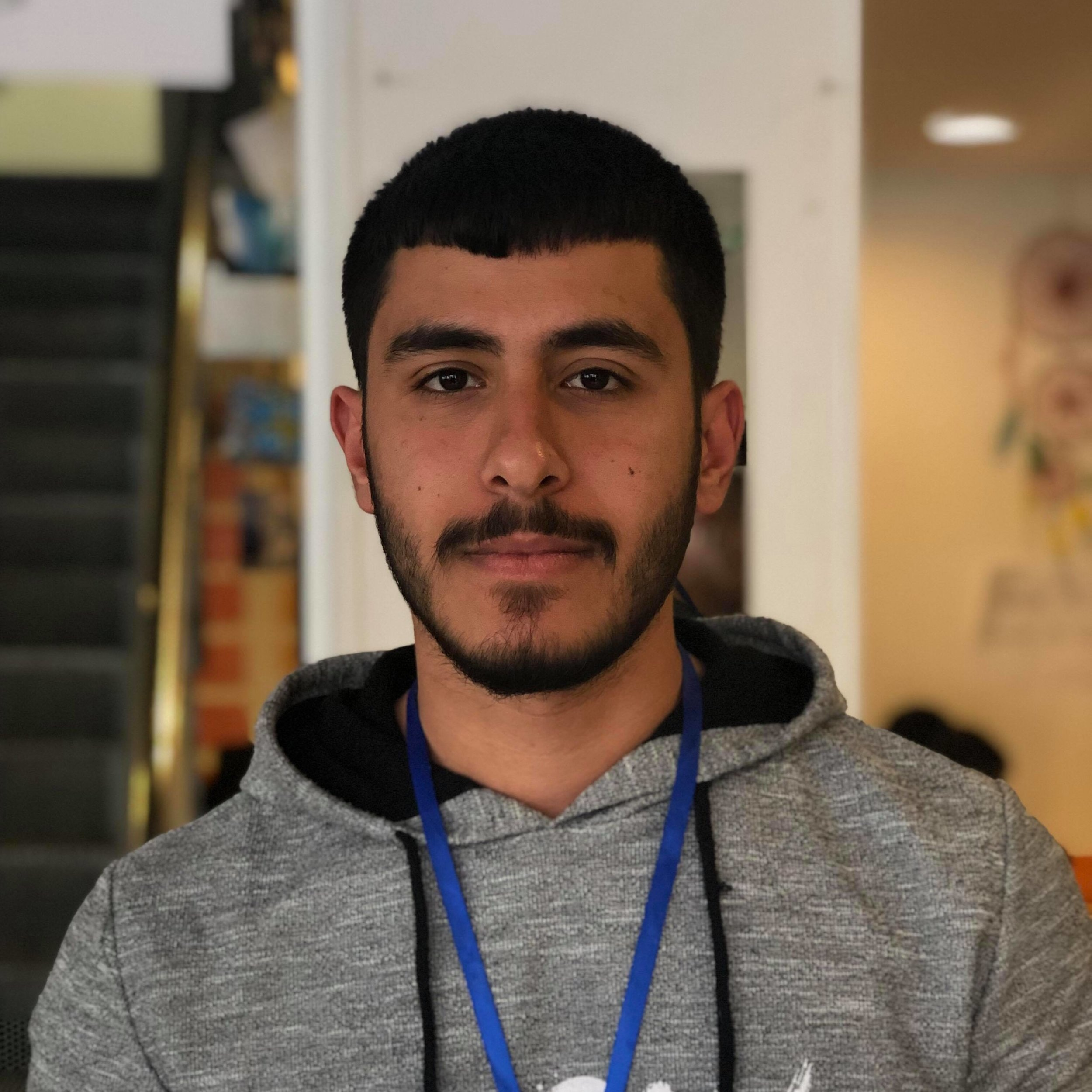 "Abdul, 22 - Syria      ""I like volunteering because we are helping people.""  Abdul loves fitness class."