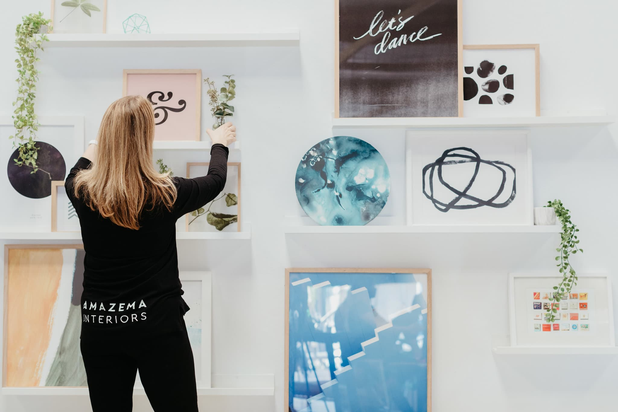 Image of Amy from Amazema styling a feature wall