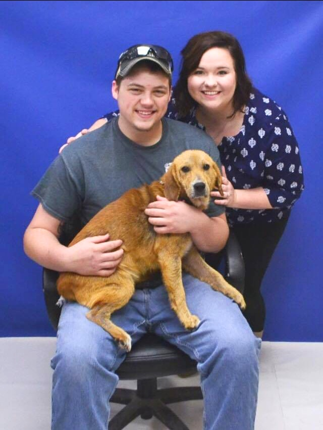 A couple with their adopted dog