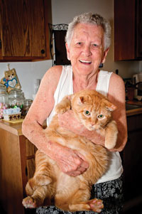A senior woman and her cat