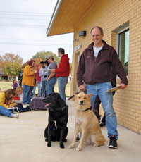 Pets and owners outside of the shelter