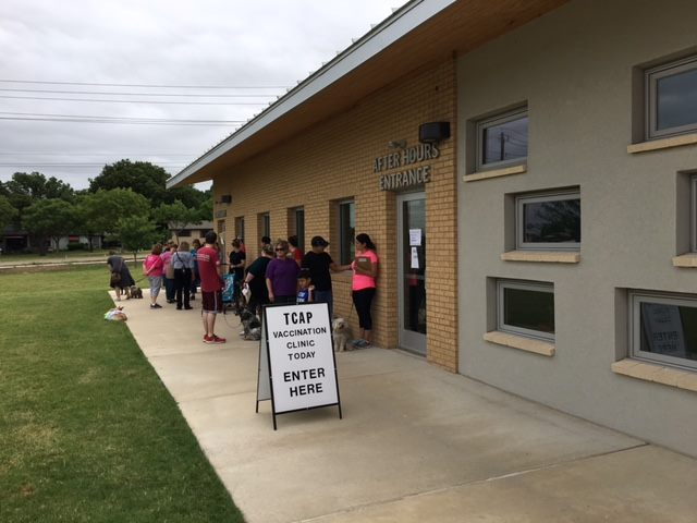 Line of pet owners outside the TCAP Vaccination Clinic