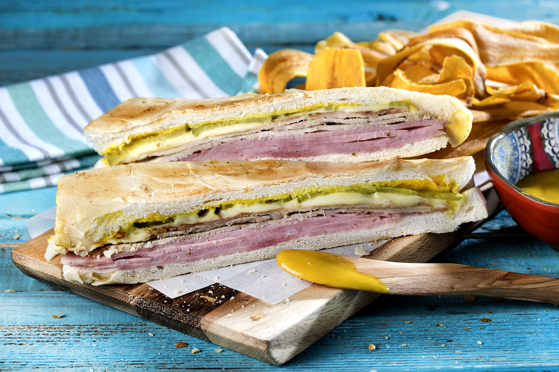 Versailles Bakery Cuban sandwich served with plantain chips