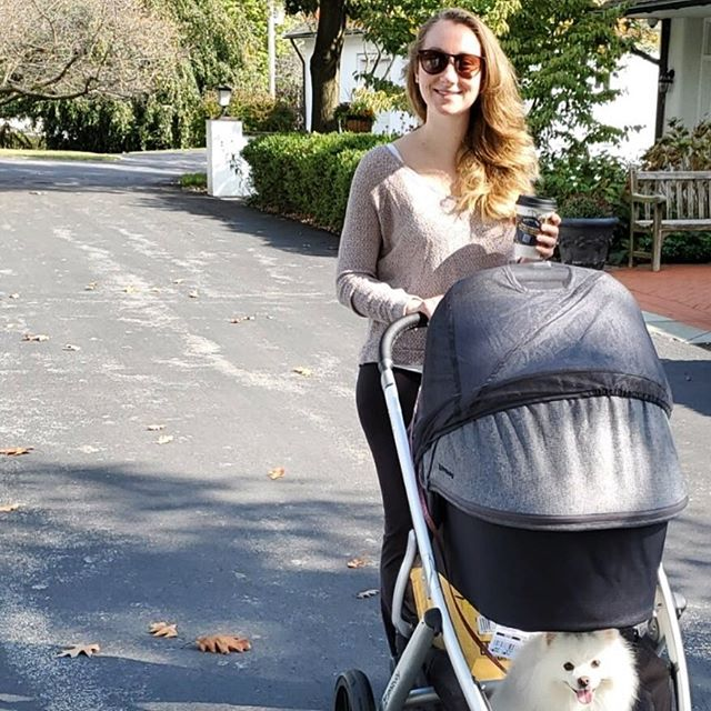 """Slowly easing my way back into gentle and joyful movement with some fresh air, a coffee, a sweet baby, and a dog who likes to hitch a ride in the bottom of the stroller 😂  I recently got a targeted ad for an online """"abs after baby"""" workout program. I flagged the ad as irrelevant because I promise you, we never need to strive for six pack abs like the person in the advertisement, not postpartum, and not ever ✌️ #gentlemovement #walking #freshair #strollin #selfcare #intuitiveeating #nourishmnt"""