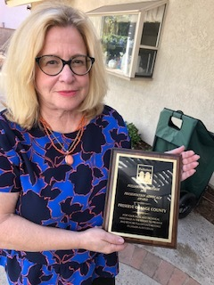 Deborah Rosenthal, accepting an award from Fullerton Heritage on behalf of Preserve Orange County