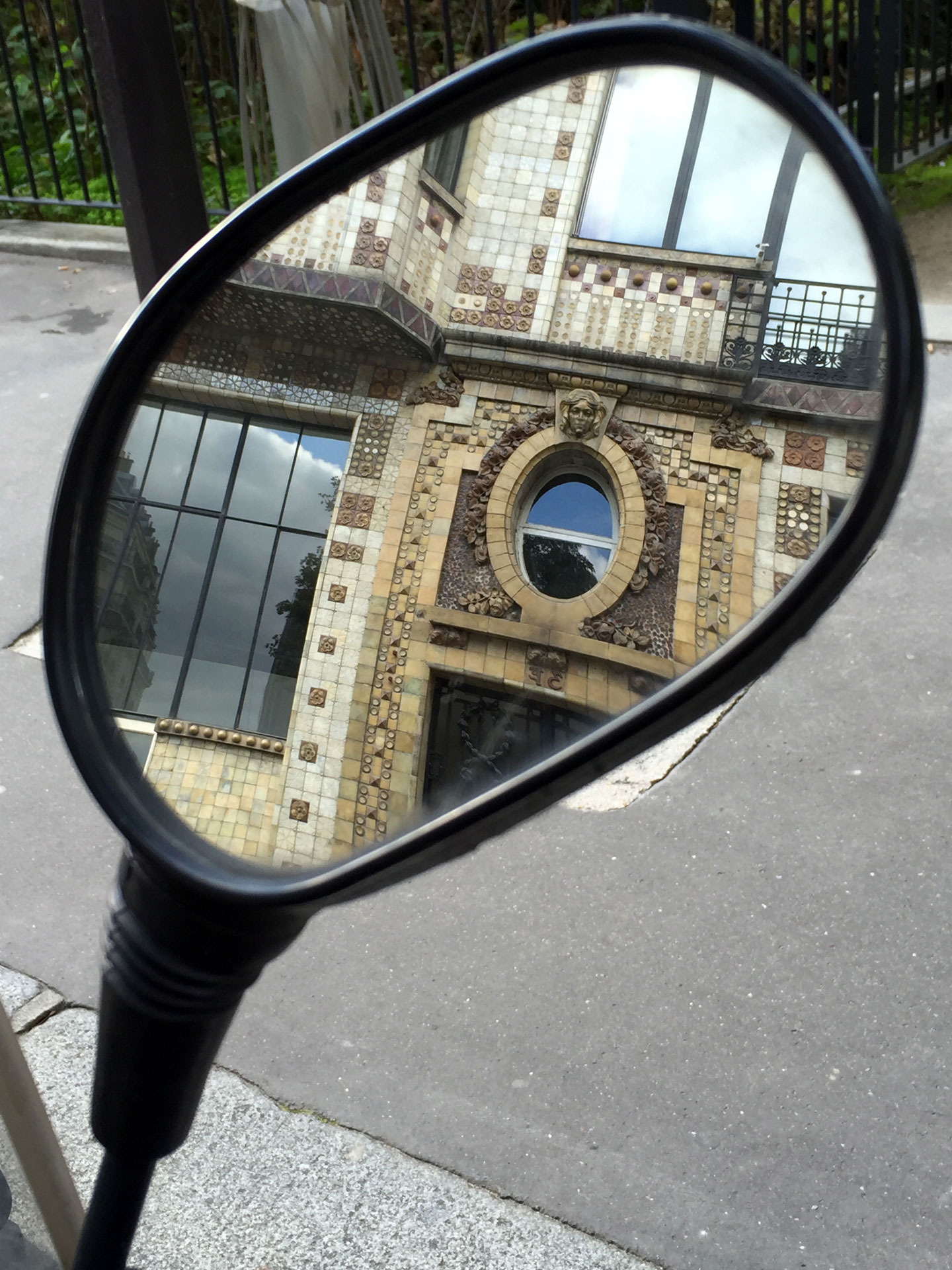Paris reflections in a mirror