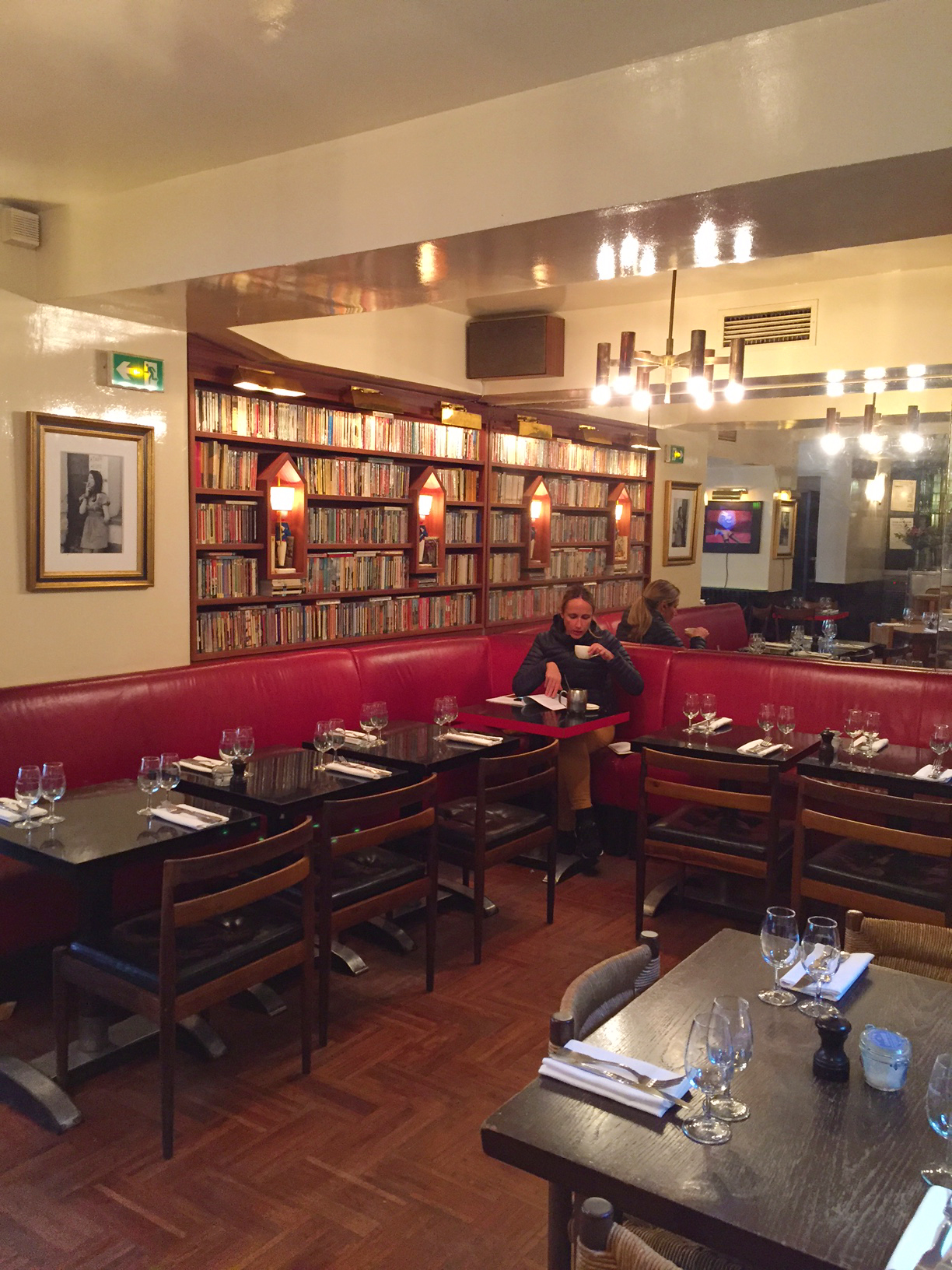The main dining room is cosy and decorated with books and vintage finds.