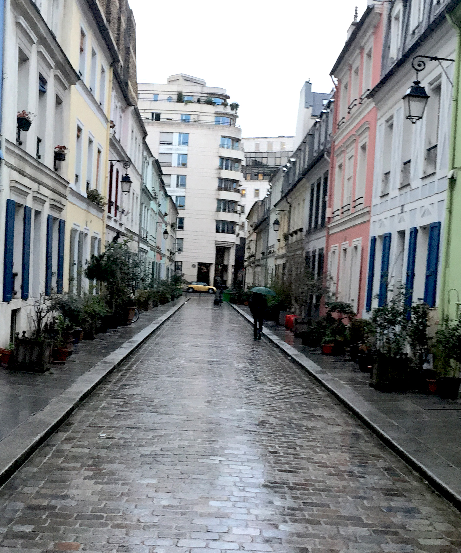 The pastel houses on rue Crémieux, a bit muted on a rainy day
