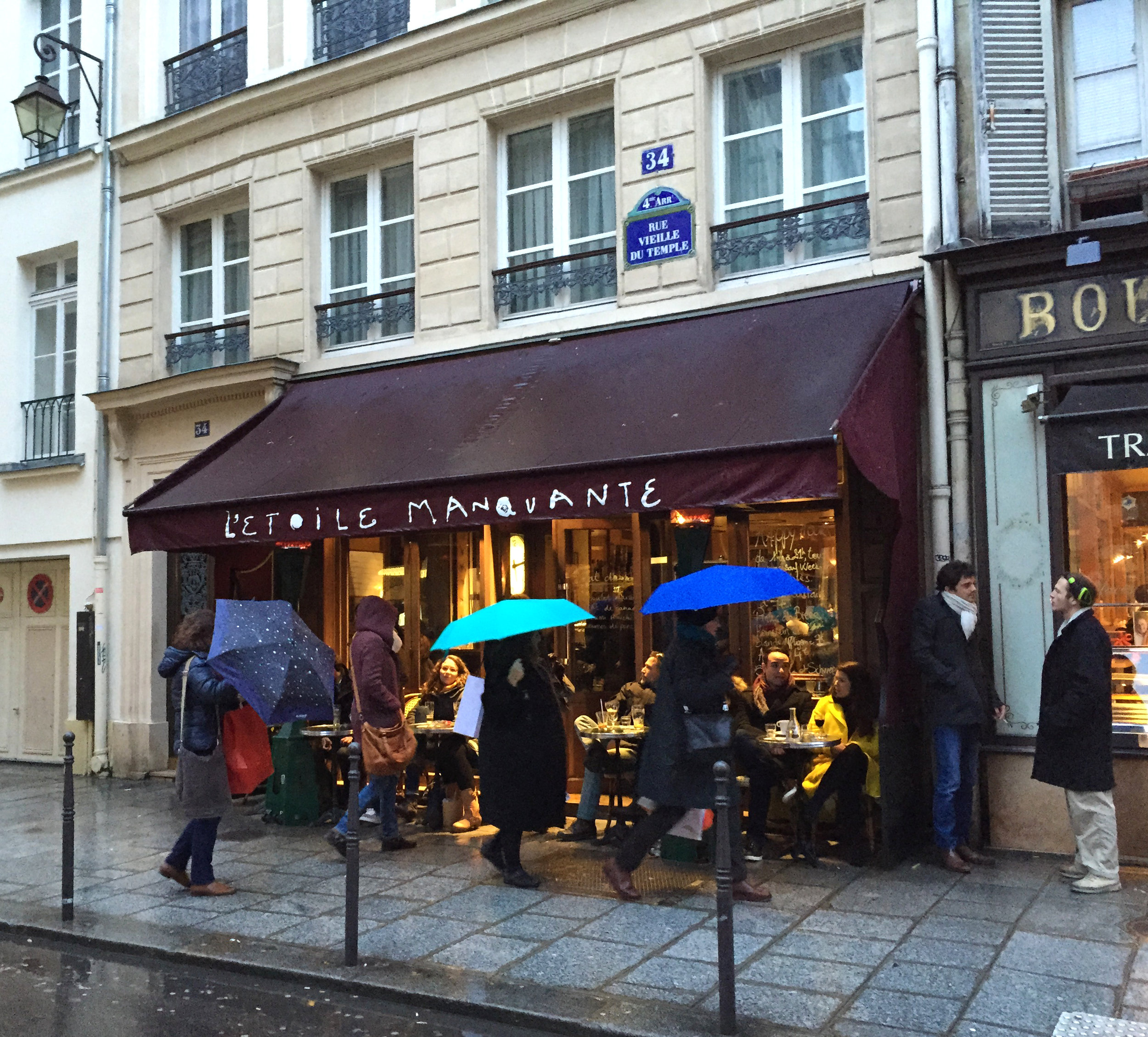 Rue Vieille-du-Temple in the 3rd arrondissement. Love the colorful umbrellas!