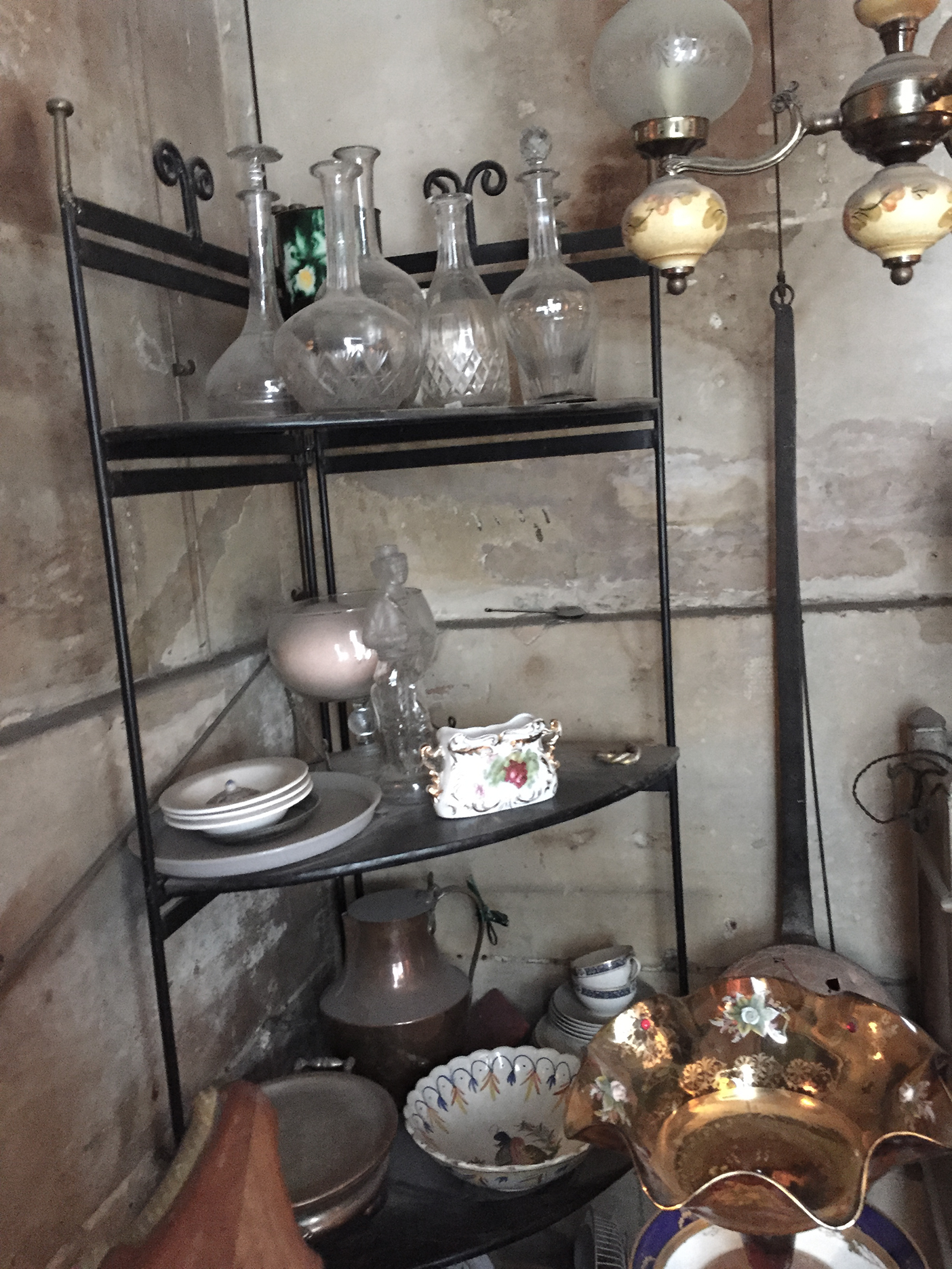 Antique decanters and, perhaps, a Quimper bowl.