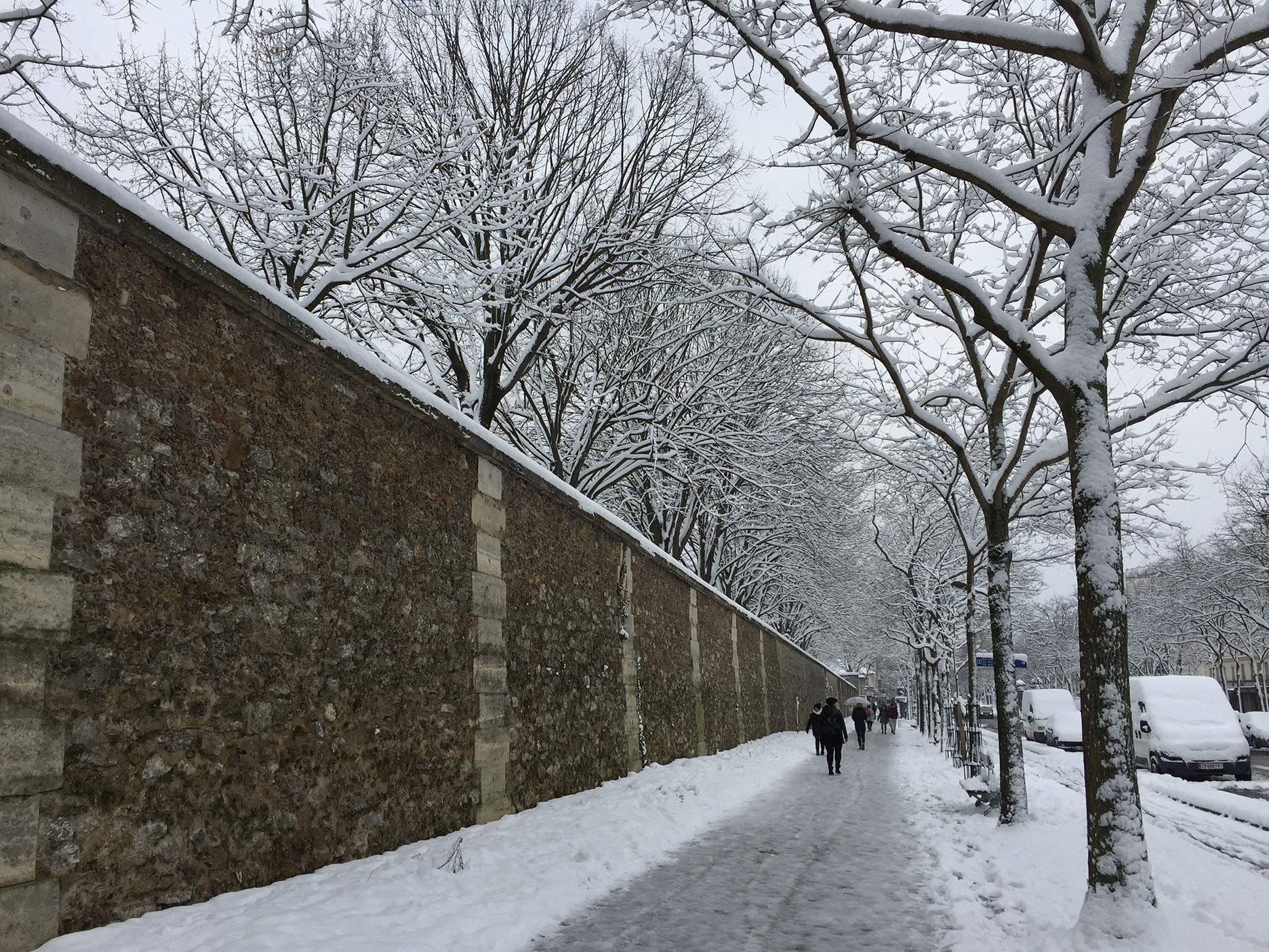 I thought the Père Lachaise cemetery would provide some interesting photo opportunities but it was closed because of the snow. We walked along the perimeter wall.