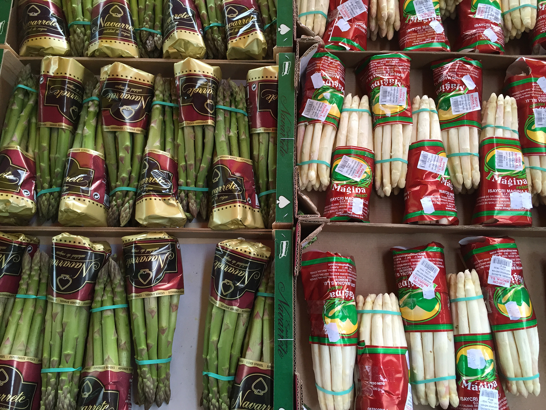 Organized display of white and green asparagus