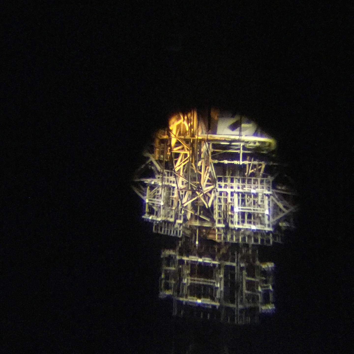 Detail of the Eiffel Tower metallic structure viewed through the telescope