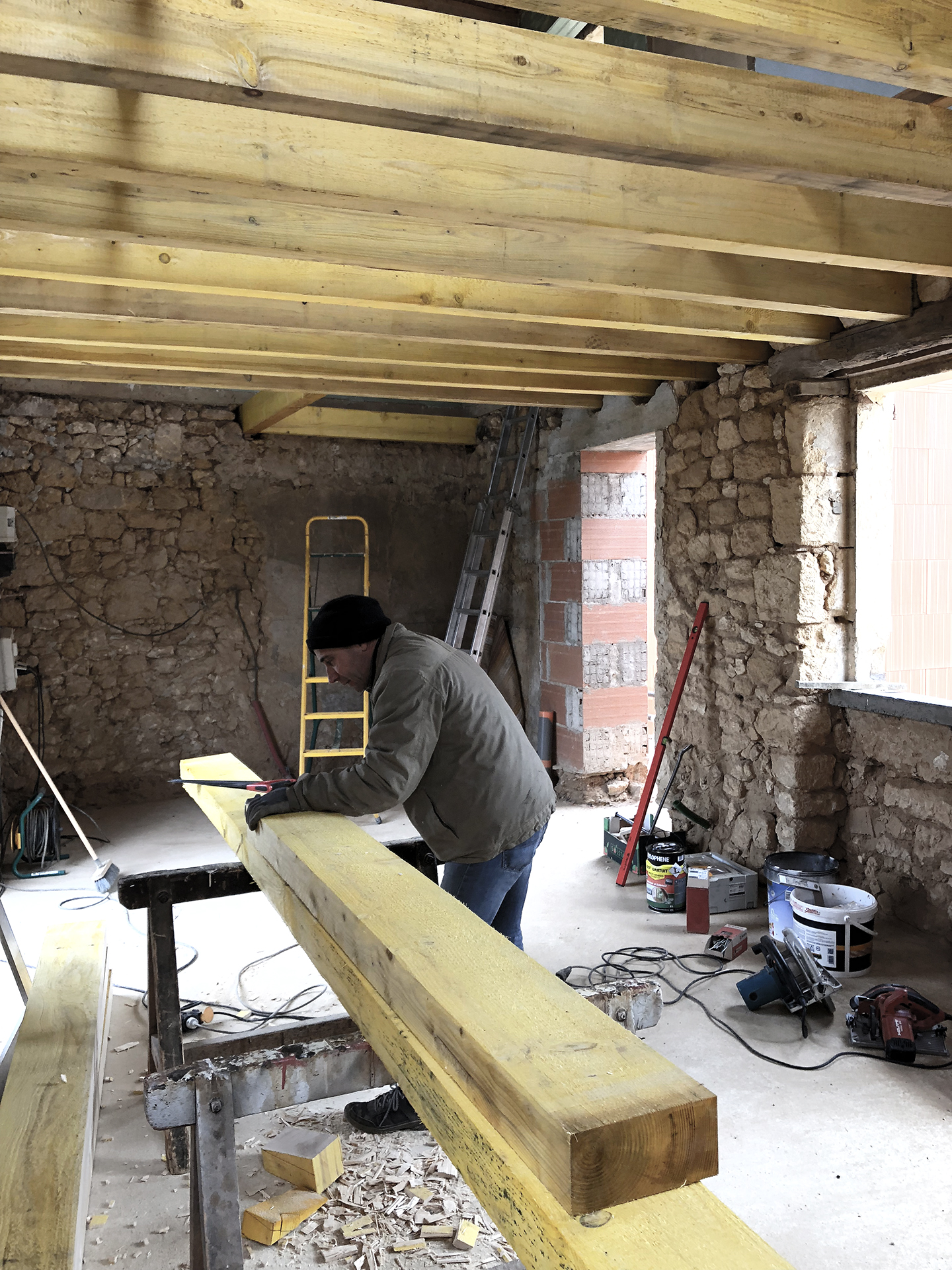 Adjusting the new beams for the great room