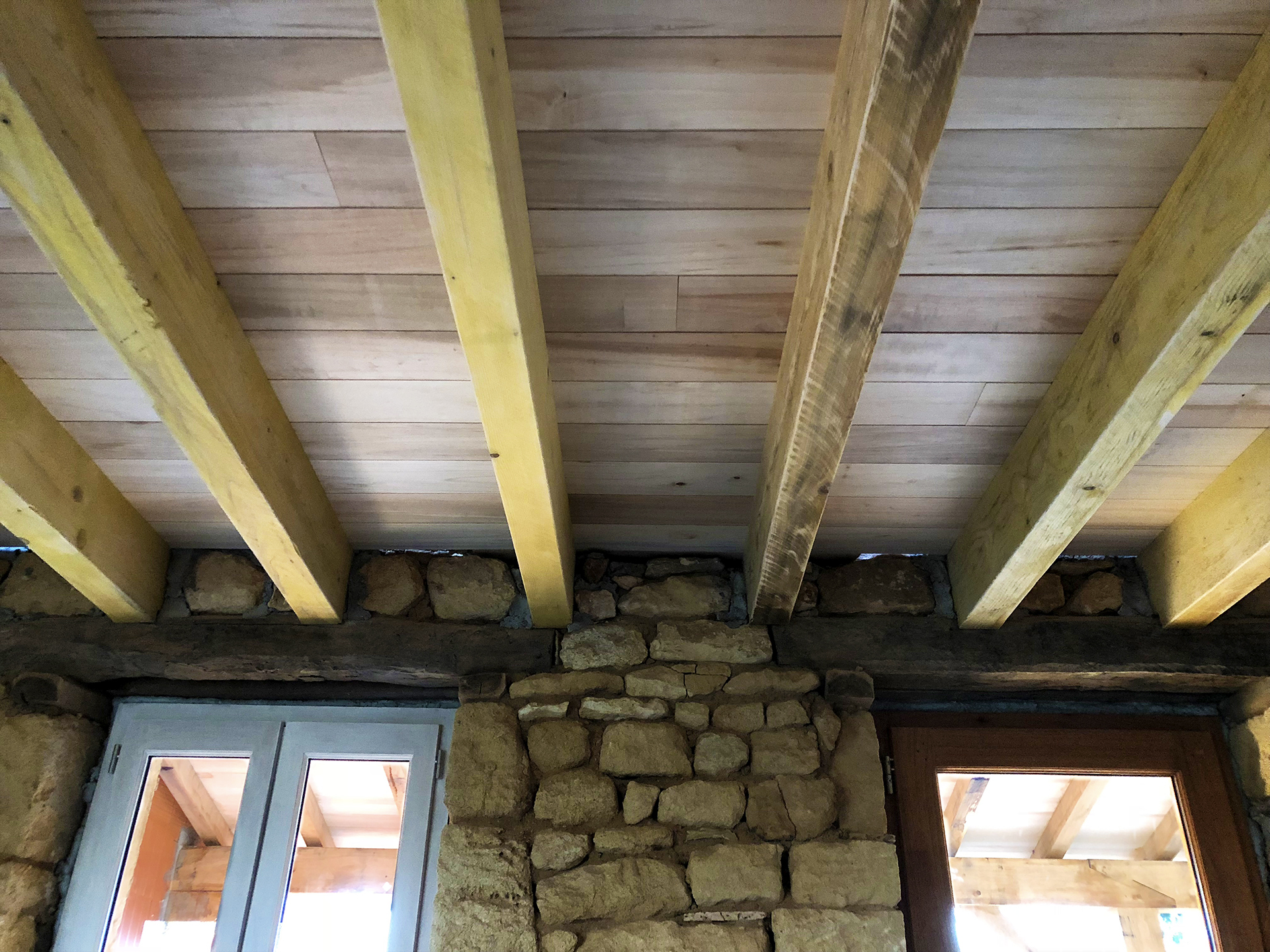 Poplar ceiling between the beams
